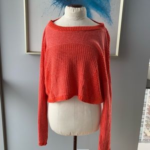 Cropped oversized sweater. Vibrant orangey red.